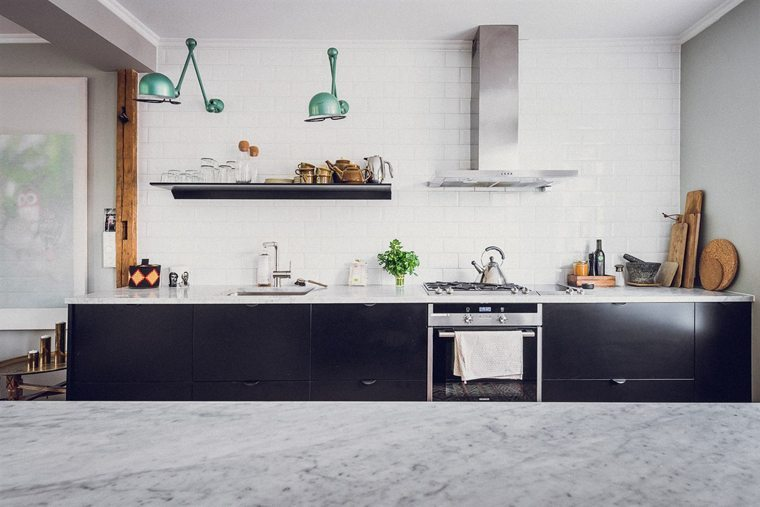 Black kitchen with marble countertop